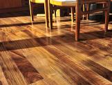 Hardwood walnut floor in residential home dining room